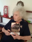 Hadassah holds a copy of her book, Courage and Conquerors